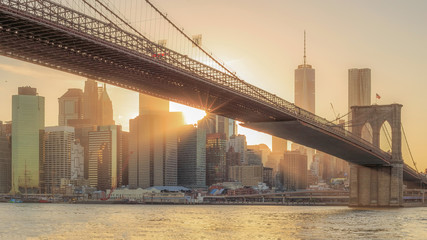 Wall Mural - The panorama view of Brooklyn Bridge with Lower Manhattan at sunset
