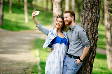 Couple taking selfie in nature