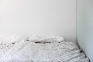 Empty Bedroom With Slightly Ruffled Sheets