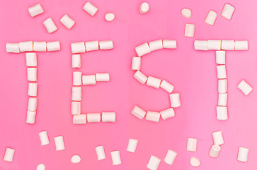 Marshmellow Test on pink background