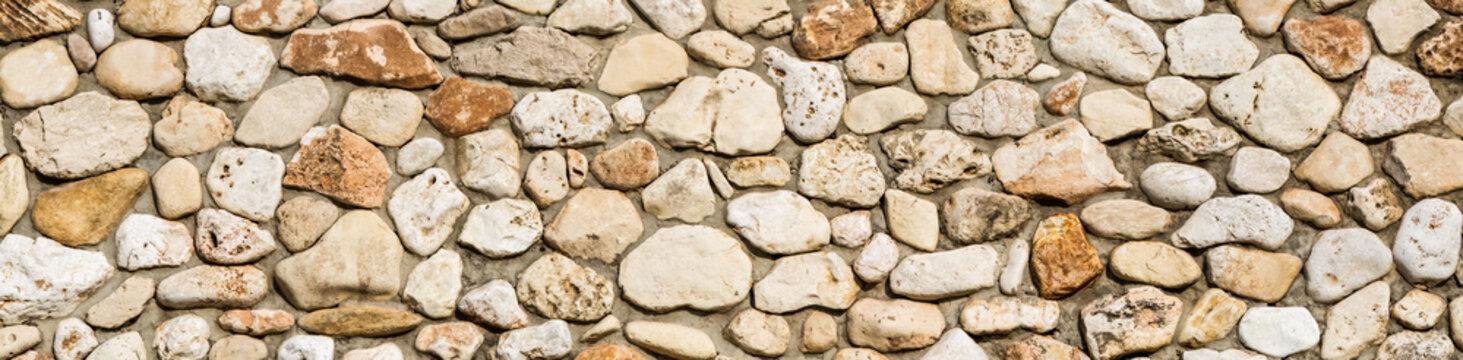 Stone wall texture background, panorama of masonry