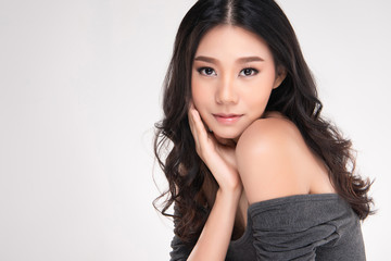 Beautiful Young Asian Woman with Clean Fresh Skin look away, Girl beauty face care. Facial treatment, Cosmetology, beauty and spa