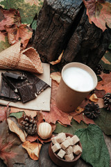 various sweets on leaves in autumn park
