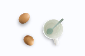 White cup and eggs separated from the white background with clipping path