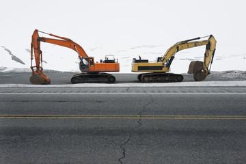 Road clearing excavators parked at roadside along Colony Glacier, Knik Valley, Anchorage, Alaska