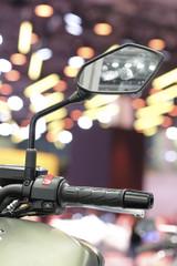 handlebar of a motorcycle close up