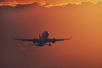 Aircraft taking off in the sunset