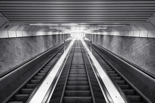 Black and white of ascending escalator