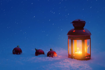 Lantern for Christmas in the snow with Christmas toys. Christmas eve