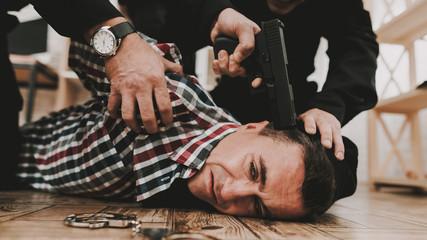 Policeman Put A Gun To The Head Of The Criminal.