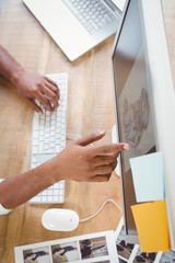 Cropped image of man pointing at design