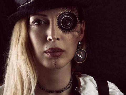 Steampunk girl portrait on black. Monocular lens