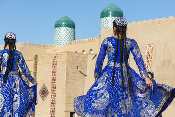 Folk dancers performs traditional dance at local festivals in Khiva, Uzbeksitan. Wall mural