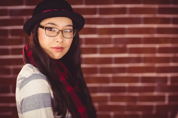 Attractive hipster posing with glasses