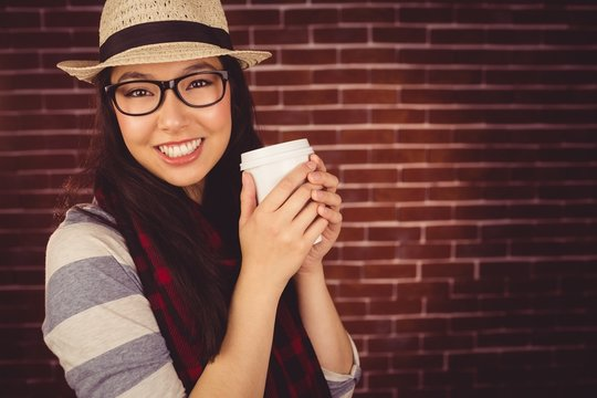 Attractive hipster holding take-away cup