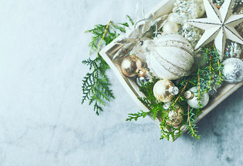 Vintage Christmas Decorations and Evergreen Twigs on a rustic wooden tray. Flatlay. Copy space