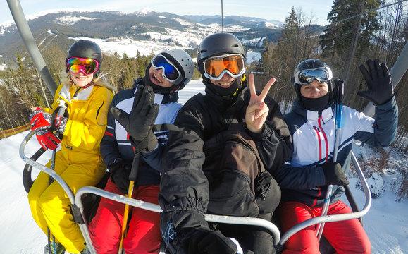 Ski, skiing - skiers on ski lift