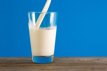 Fresh milk is poured into a glass.