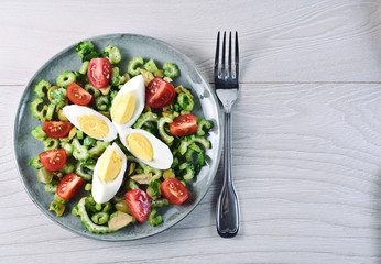 Celery salad with egg, olive and cherry tomato