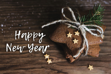 Gingerbread cookies in the shape of a star on a wooden background. Happy New year.
