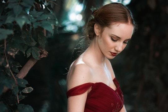 Elegant lady standing in garden portrait