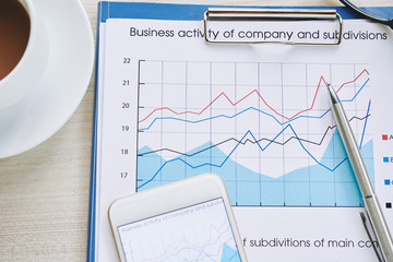 Chart of business activity and subdivisions on table of entrepreneur, view from above