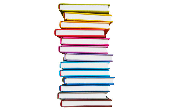 Books. A lot of books with bright covers in one vertical pile isolated on white background. Place for text. Design element, paper and leather texture. Colorful books on the shelf, close up
