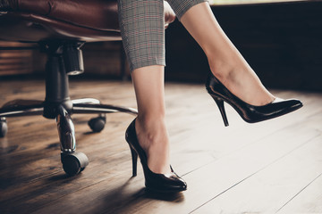 Close-up cropped classic business lady's graceful legs in black
