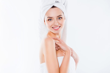Portrait of cute half turned woman after shower with turban on h