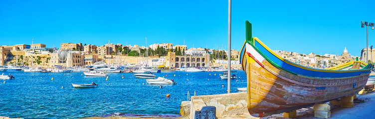 Panorama of Kalkara marina with old wooden boat, Malta