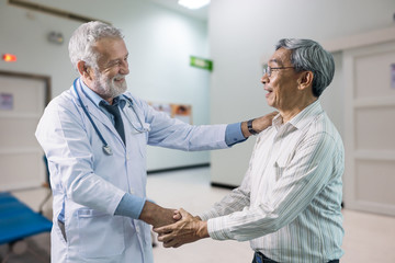 The senior doctor and elderly patient happiness together