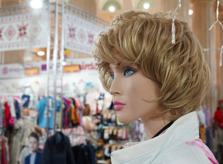 Female mannequin presented in a clothing store.