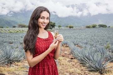 Wall Mural - Mexican woman in a landscape of Tequila.