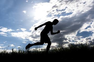 Men running outdoor on silhouette background.