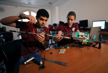 Students in a classroom test a prototype navigational smart stick designed to help visually impaired people in Cairo