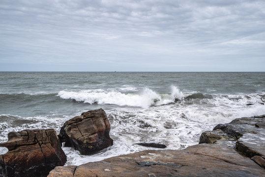 waves of the Atlantic Ocean crashing against the rocks