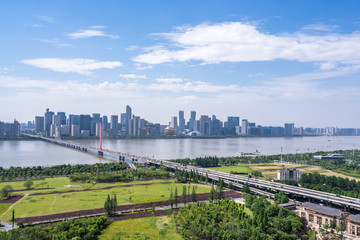 busy traffic road with city skyline in hangzhou china
