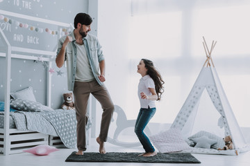 Handsome Young Father Dancing with Little Girl