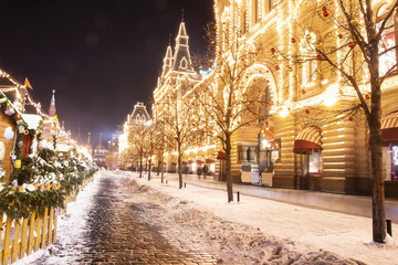Christmas in Moscow, Russia. Red Square. Christmas and New Year celebration in night Moscow. Night light shining and glowing on red square near GUM. City street decorated for Xmas. Winter cityscape. Fotomurales
