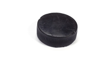 The old hockey puck on white background