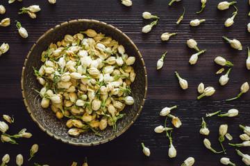 Brass Bowl of Dried Jasmine Flowers