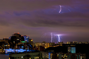 bright strikes of lightning during an evening thunderstorm in Moscow