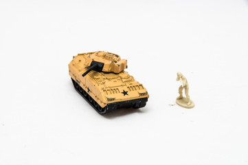 Miniature toy soldier with tank