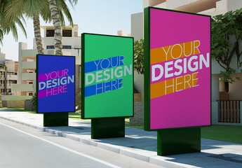 Three Advertising Kiosks on Sidewalk Mockup