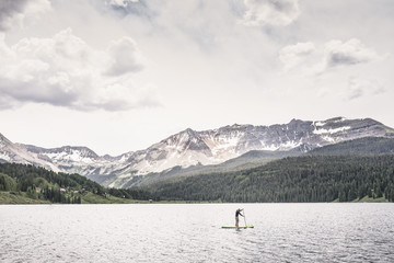 Man paddleboarding on Trout Lake, Telluride, Colorado, USA