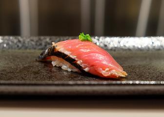 Freshly prepared raw Hay smoked bonito sushi on a plate