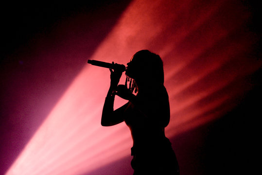 Silhouette of an unrecognizable female singer