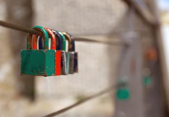 Love padlocks on the railing of a bridge.
