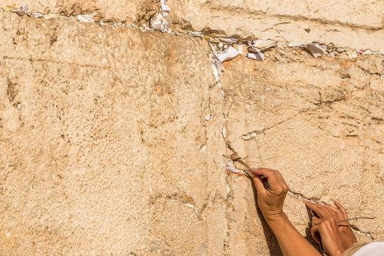Women hands. Prayers hands at Wailing Wall in Jerusalem, Israel.