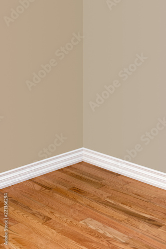 Corner Of Empty Bedroom With Hardwood Floor Baseboard And Walls